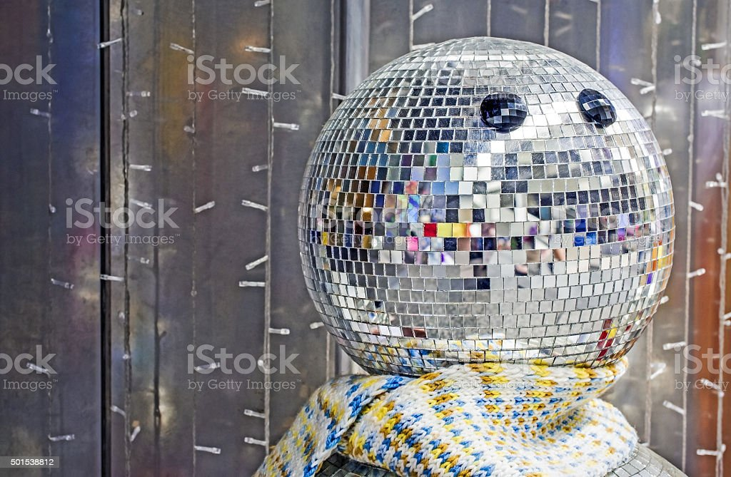 Happy snowman made from disco balls stock photo