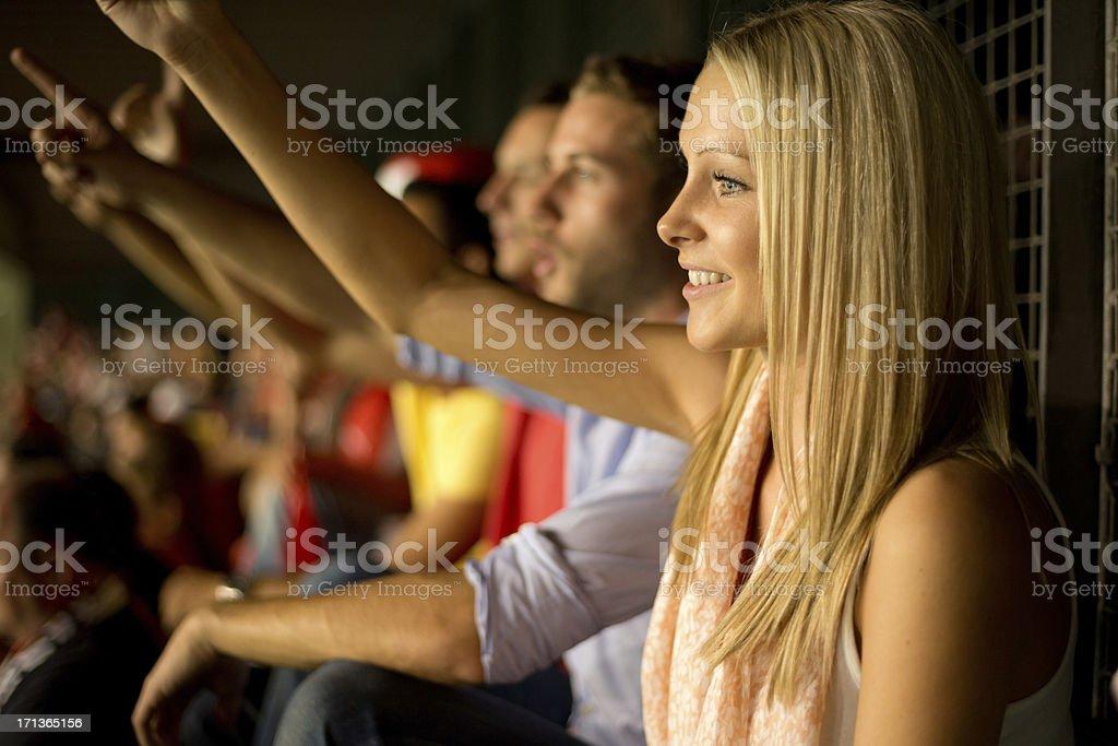happy soccer fans in stadium stock photo