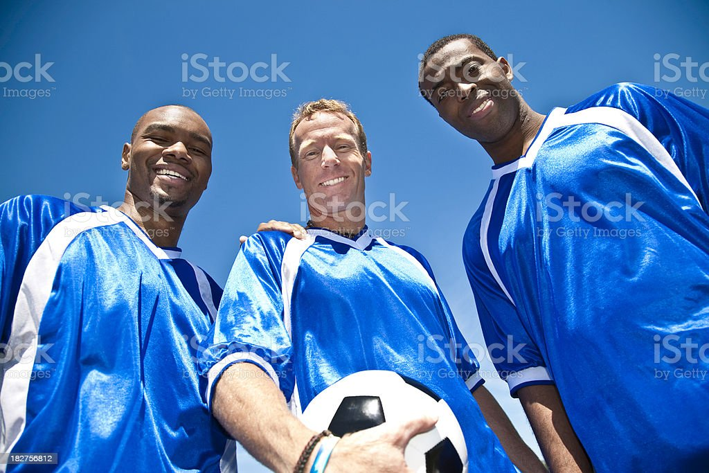 Happy Soccer Teammates Against Sky Backdrop royalty-free stock photo
