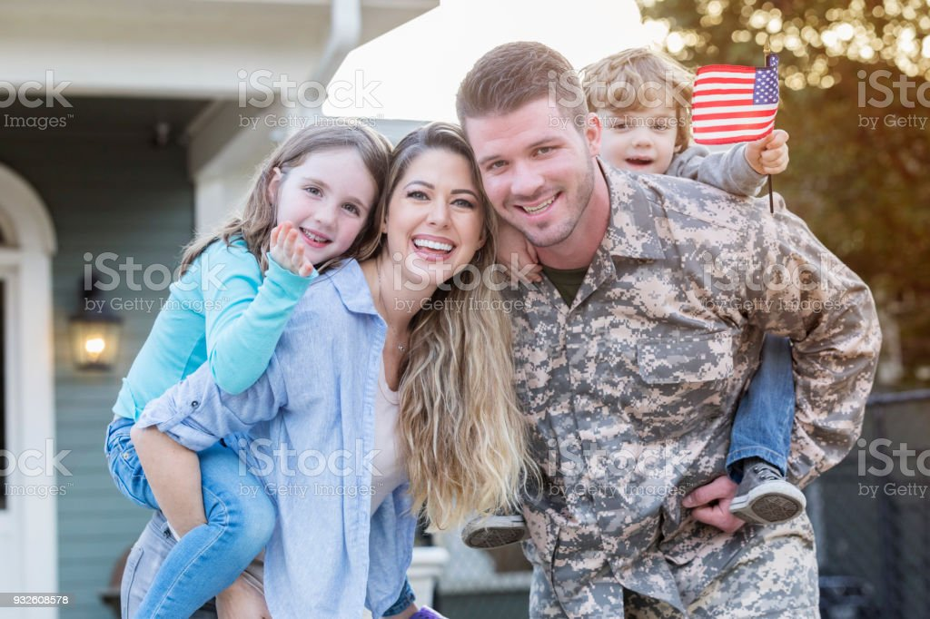 Happy soldier home from deployment stock photo