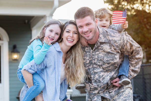 happy soldier home from deployment - armed forces stock photos and pictures