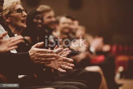 585298714 istock photo Happy spectators clapping in the theater, close up of hands 1214332081