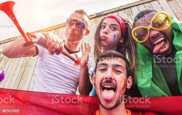 Happy sport supporters having fun during football world game young picture id927411312?b=1&k=6&m=927411312&s=612x612&h=0z45hmohp 1bh juex i kd52ydn5xouv lbmn1i56w=