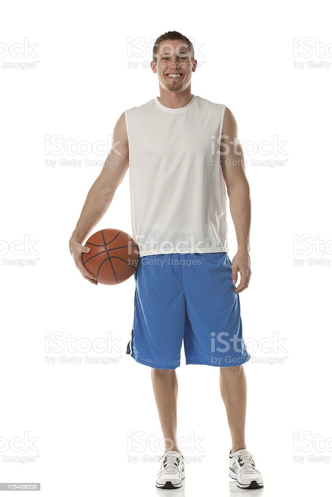 Happy sportsman holding a basketball royalty-free stock photo