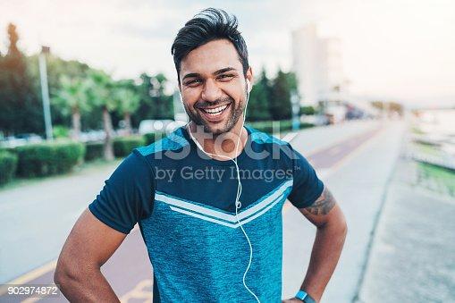 istock Happy sportsman 902974872