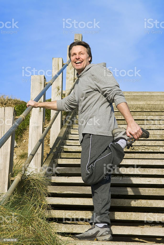 happy sportsman stretching. royalty-free stock photo