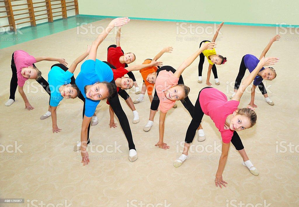 Happy sporty children in gym stock photo