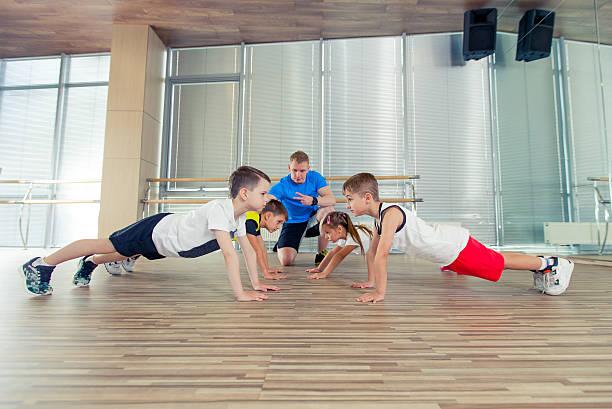Happy sporty children in gym. stock photo