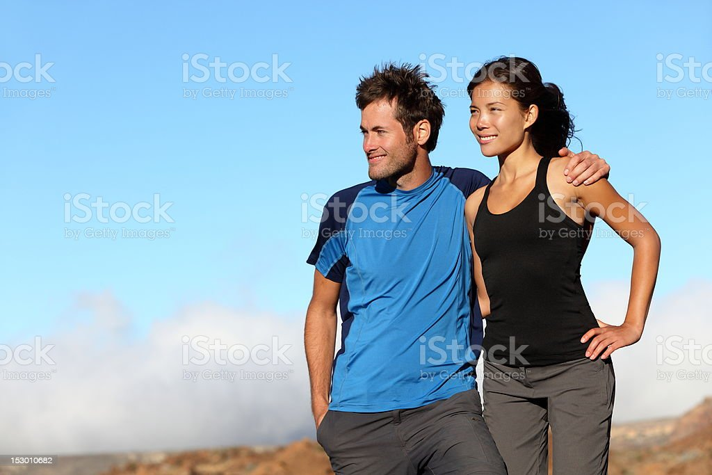 happy sporty couple looking royalty-free stock photo