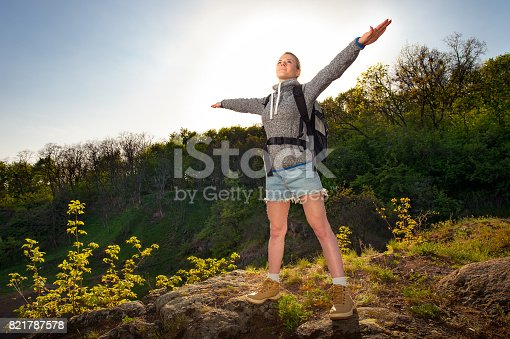 629376126istockphoto Happy sporty Traveler woman relaxing at sunrise beam, Female model breathing fresh air outdoors, Healthy active vacation concept 821787578