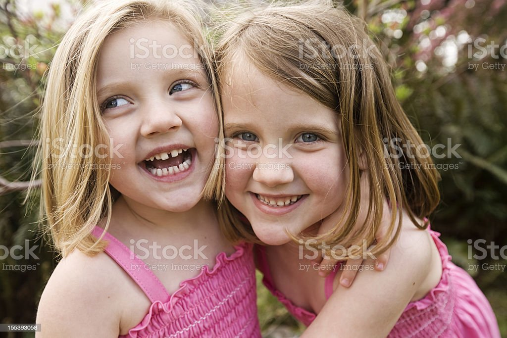 Happy Spring sisters laughing having fun together royalty-free stock photo