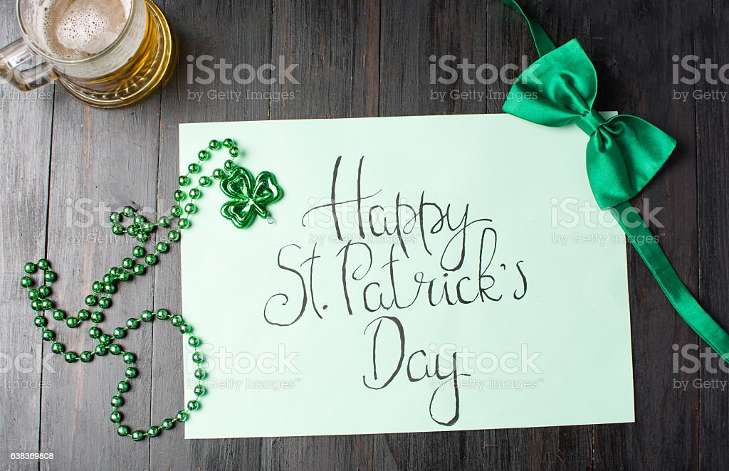 Happy St Patrick day calligraphy card on black stock photo