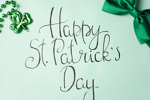happy st patrick day calligraphy card - st patricks days stock photos and pictures
