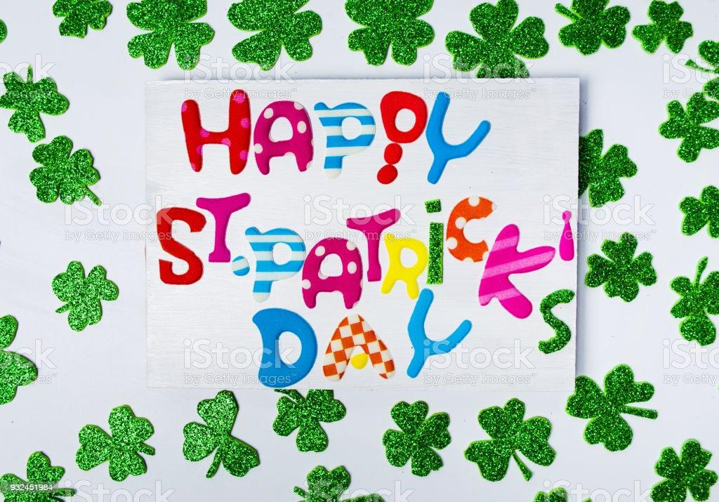Happy St. Patrick's Day card with shiny clovers stock photo