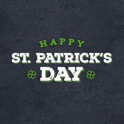 Happy St. Patrick's Day Grunge Text Over Black Chalkboard Background