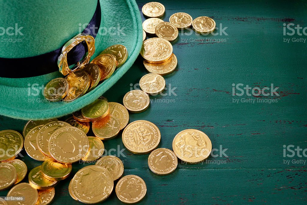 Happy St Patricks Day leprechaun hat with gold chocolate coins stock photo