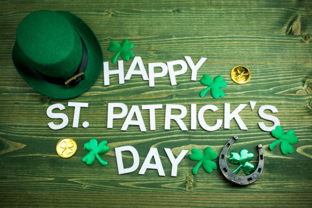 Happy St Patricks Day letters on green wooden background Happy St Patricks Day letters on green wooden st patricks day stock pictures, royalty-free photos & images
