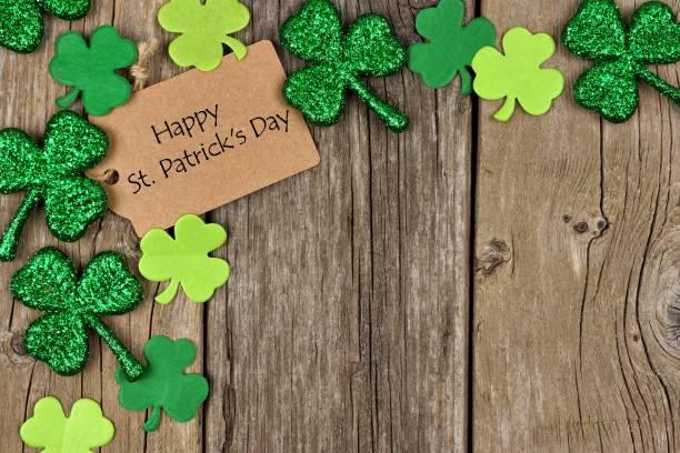 Happy St Patricks Day tag with shamrock corner border stock photo