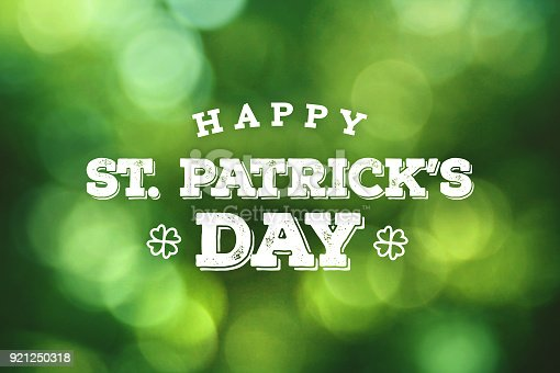 Happy St. Patrick's Day Text Over Green Bokeh Lights Background