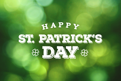 Happy St. Patrick's Day Text Over Green Bokeh Lights