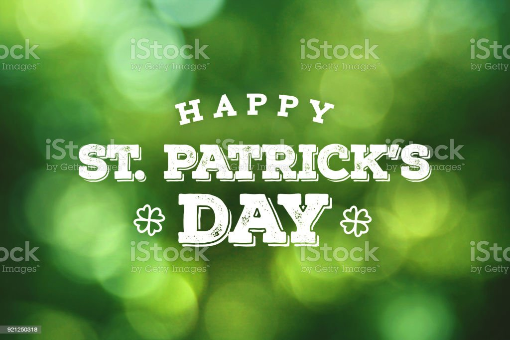 Happy St. Patrick's Day Text Over Green Bokeh Lights stock photo