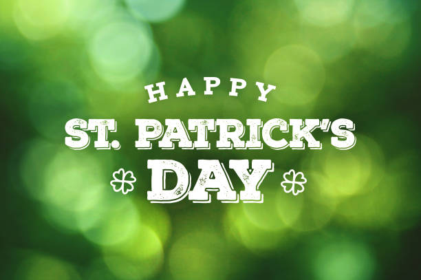 happy st. patrick's day text over green bokeh lights - st patricks day stock photos and pictures