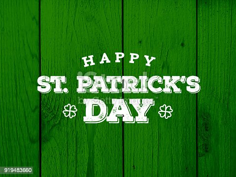 istock Happy St. Patrick's Day Text Over Green Wood Texture 919483660
