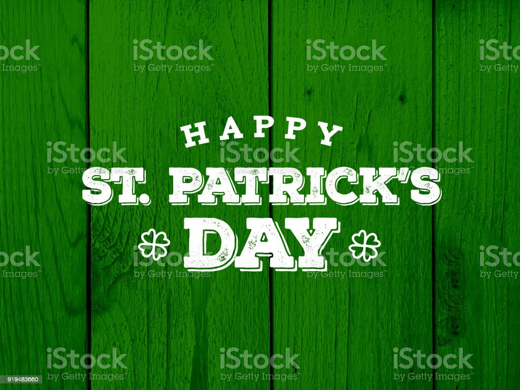 Happy St. Patrick's Day Text Over Green Wood Texture stock photo
