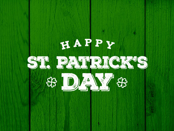 happy st. patrick's day text over green wood texture - st patricks day stock photos and pictures