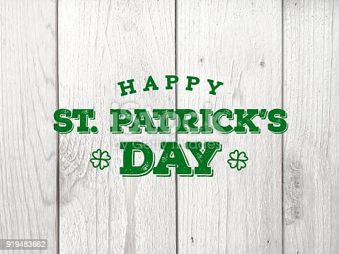 istock Happy St. Patrick's Day Text Over Whitewashed Wood Texture 919483662