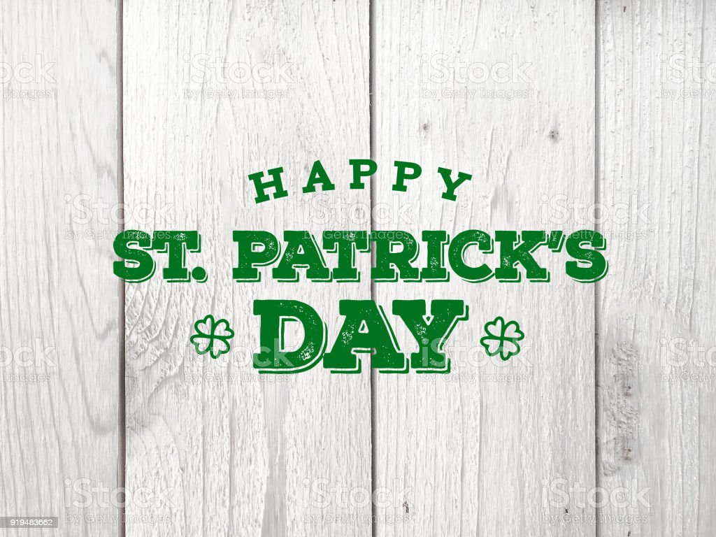 Happy St. Patrick's Day Text Over Whitewashed Wood Texture stock photo