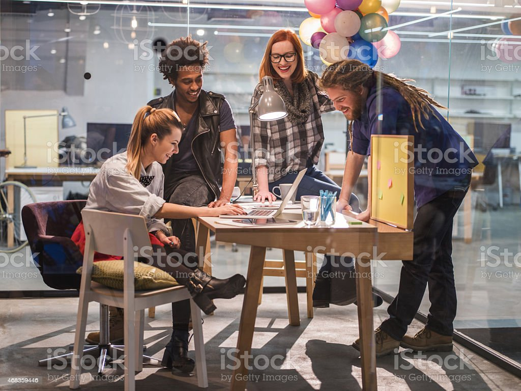 Happy start up team using computer in the office. royalty-free stock photo