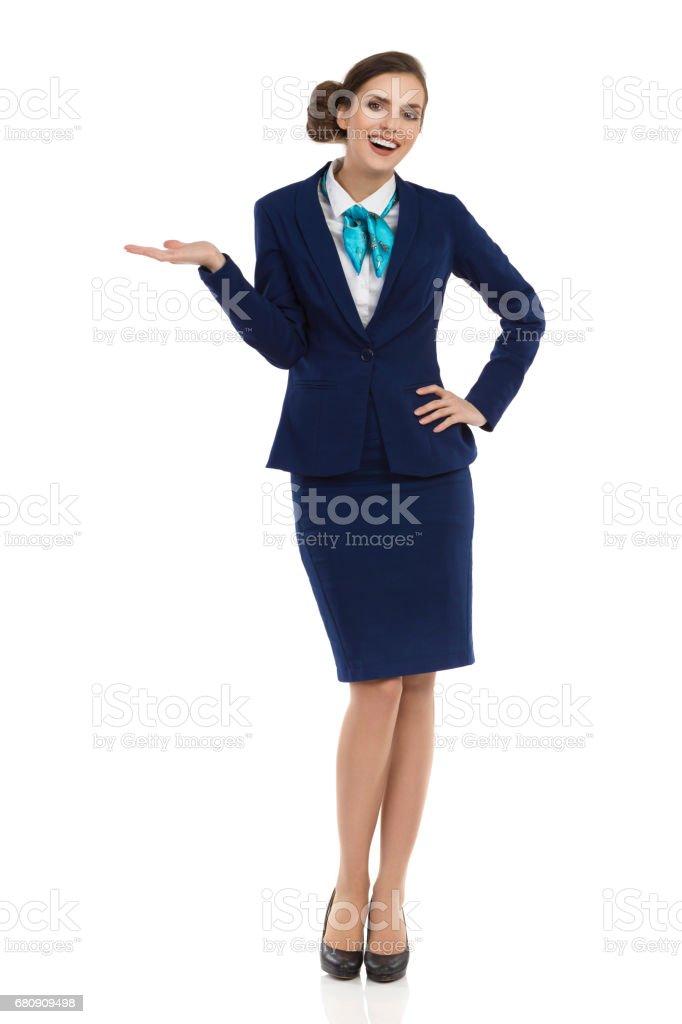 Happy Stewardess Is Presenting - foto de stock