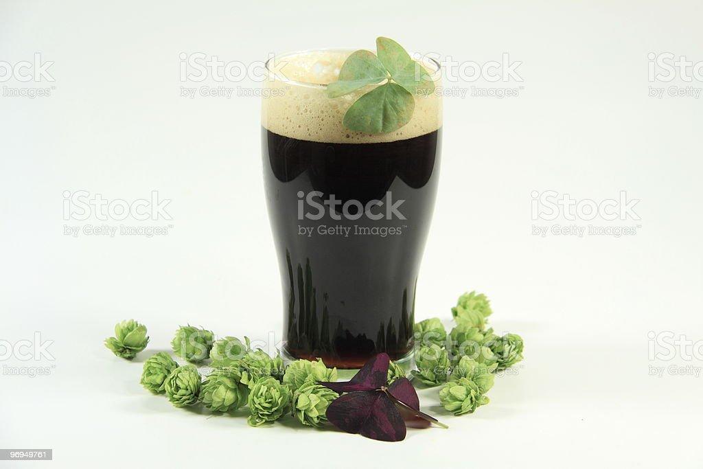 Happy St.Patricks Day - Dark Irish Porter and Shamrocks royalty-free stock photo