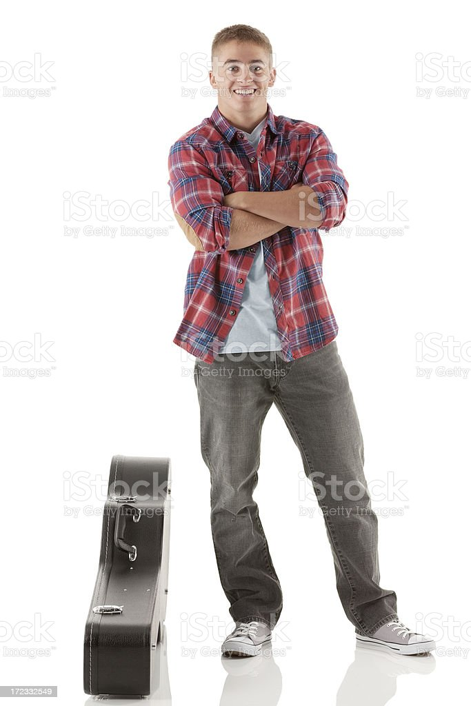 Happy street musician standing with his arms crossed royalty-free stock photo