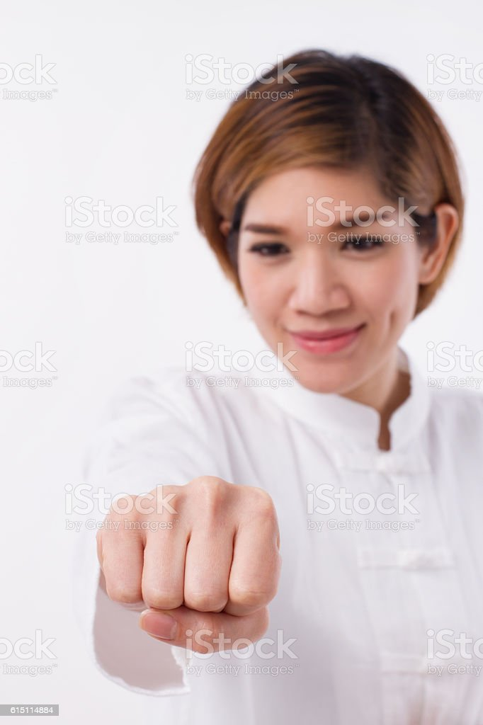 happy, strong, confident asian woman punching, practice kungfu o stock photo