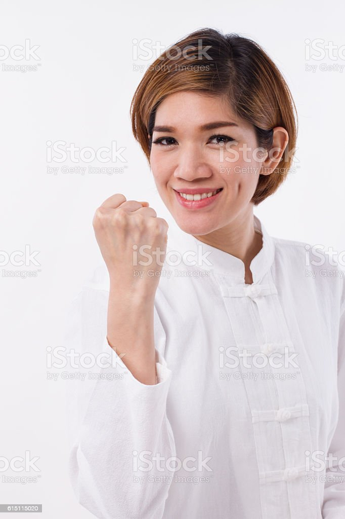 happy, strong, confident kungfu woman, self defense stock photo