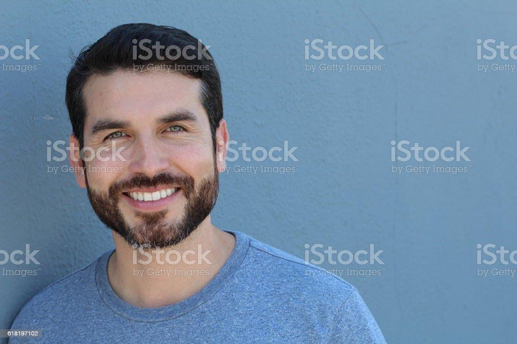 Happy stubble guy in blue, portrait stock photo
