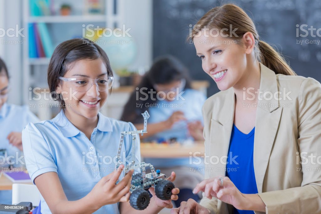 Happy student builds robotic vehicle stock photo