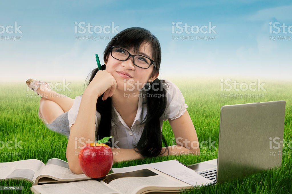 Happy student daydreaming at field Lizenzfreies stock-foto