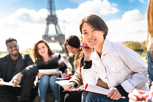 happy student in paris during the lesson - cultura francesa fotografías e imágenes de stock