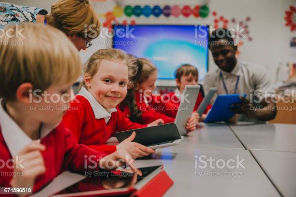 Happy Student In Technology Lesson Stock Photo - Download Image Now