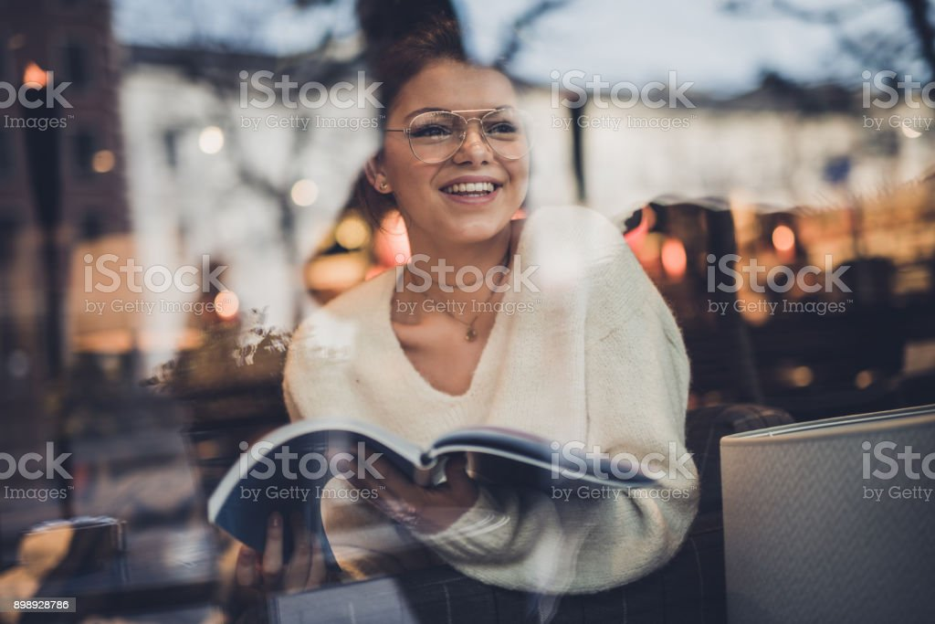 Happy student learning in cafeteria. stock photo