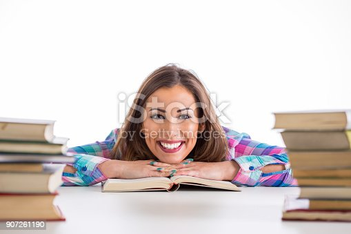 istock Happy student reading and thinking 907261190