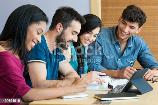 istock Happy student studying together 492654918