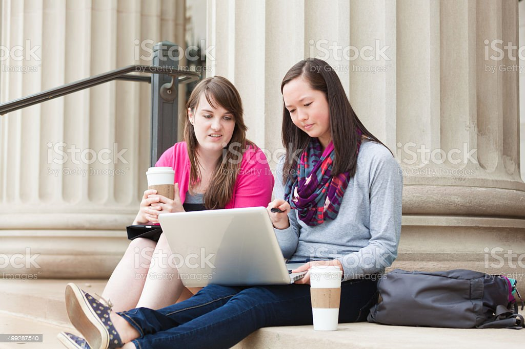 Happy Student Studying with WIFI Laptop Computer on University Campus stock photo