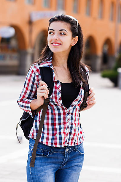 Happy student with backpack stock photo