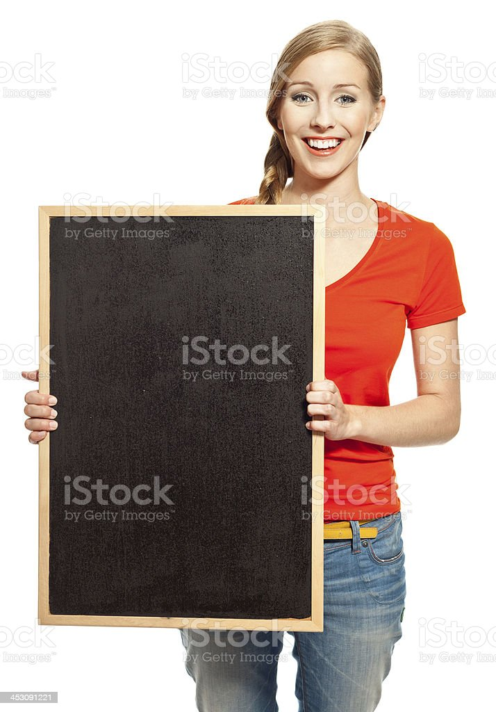 Happy student with blackboard Portrait of college student standing with small blackboard and smiling at the camera. Studio shot, white background. 18-19 Years Stock Photo