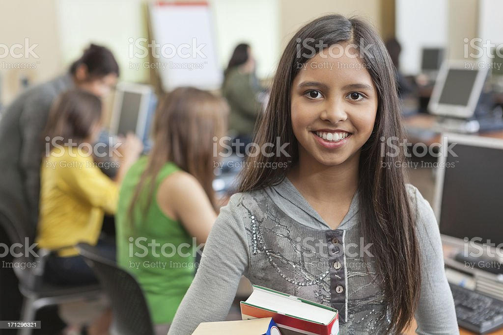 Happy student with books in the school computer lab royalty-free stock photo