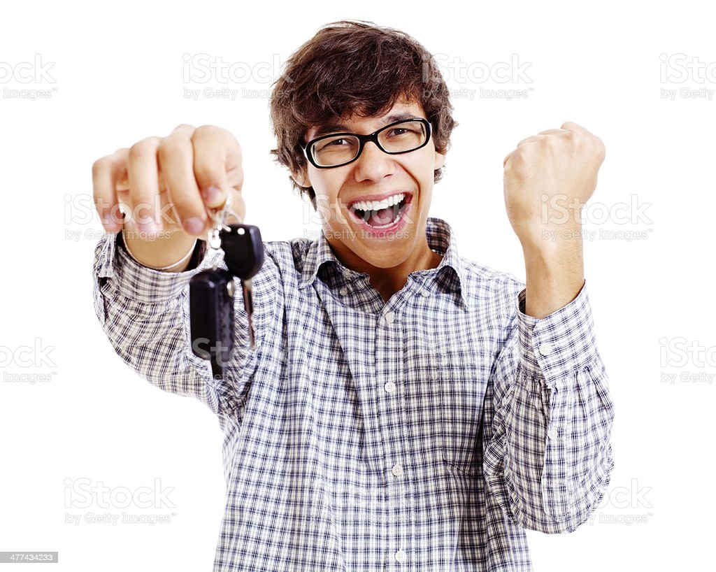 Happy student with car keys closeup stock photo